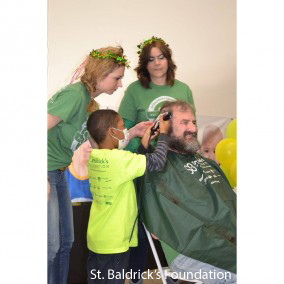 Dr. Bernstein getting his head shaved.